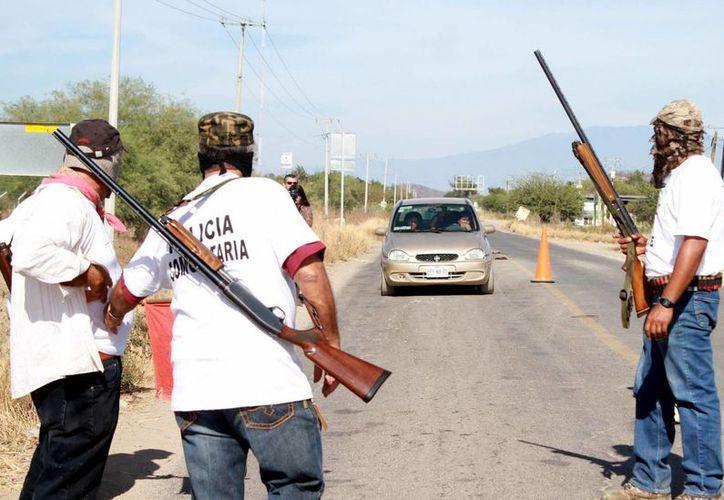 El presidente municipal negó que los accesos a Buenavista estén bloqueados por los pobladores de La Ruana. (Archivo/Notimex)