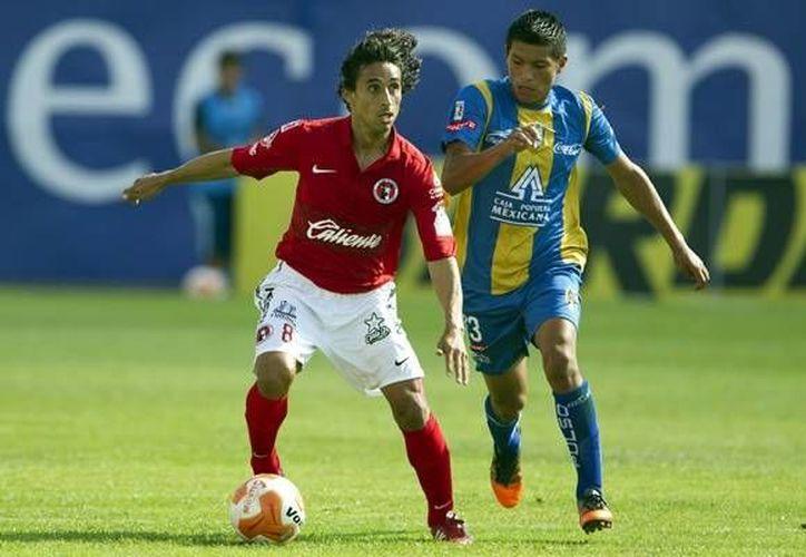 Arce (i) llega a Chivas en el ocaso de su carrera, después de haber jugador con Xolos, Atlante, Veracruz, entre otros equipos. (mediotiempo.com)