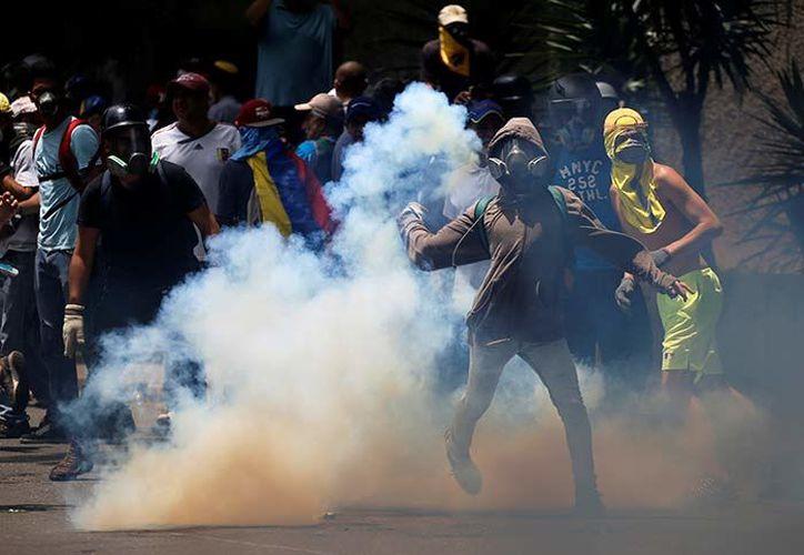 La oposición acusa a Maduro de ser responsable de la grave crisis que sufre el país . (Excelsior)