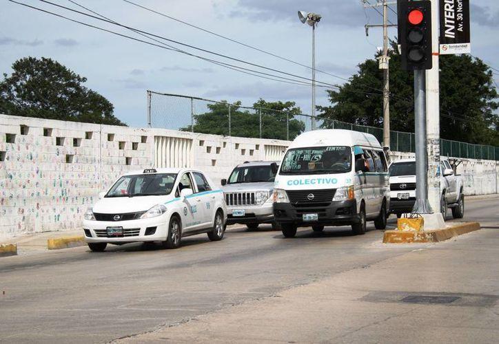 Al menos 11 rutas de transporte colectivo de Playa del Carmen cobrarán ahora siete pesos. (Octavio Martínez/SIPSE)