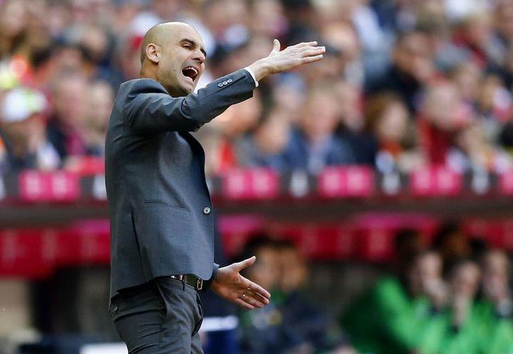 El técnico catalán, que será sustituido por el italiano Carlo Ancelotti, fue ovacionado por los 75 mil espectadores que llenaron el Allianz Arena. (AP)