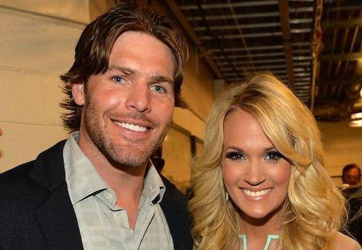 Carrie Underwood y su esposo Mike Fisher tendrá a su primer hijo en la primavera del próximo año. (tasteofcountry.com)
