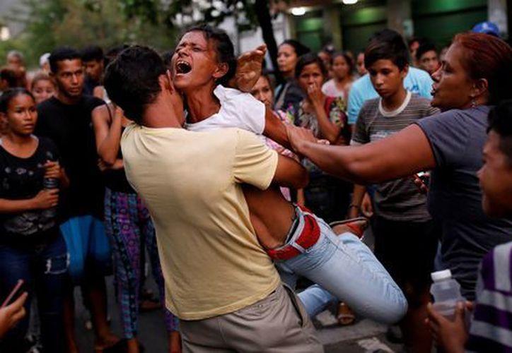 Los fallecidos fueron 66 hombres y dos mujeres que visitaban las celdas. (Reuters)