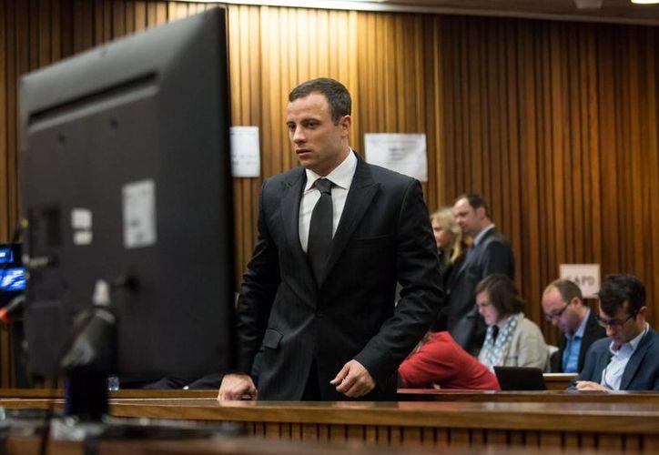 Pistorius a su llegada a la corte de Pretoria. Sostiene que mató a su novia porque la confundió con un intruso. (Foto: AP)