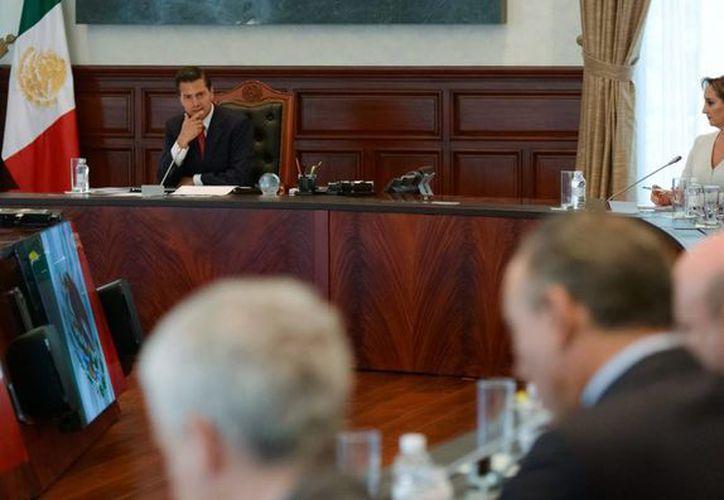 El Presidente recibió a los miembros de su gabinete en la residencia oficial de Los Pinos. (Notimex)