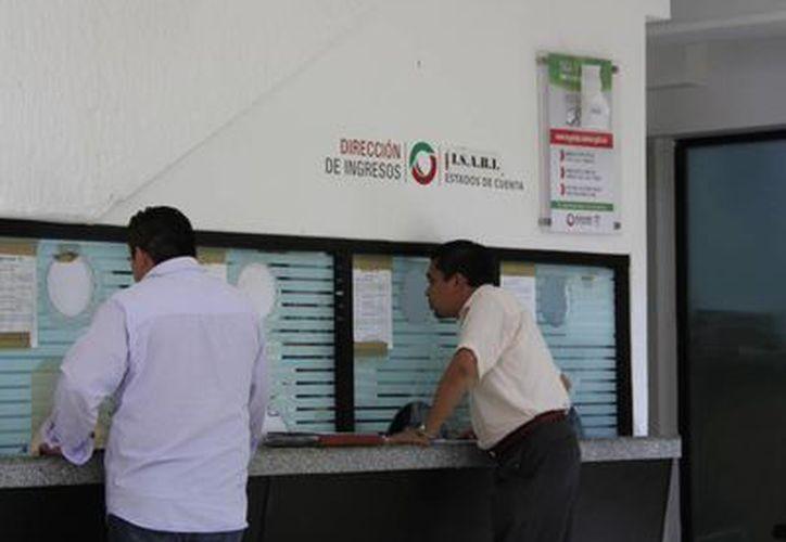 A los deudores se les quitan las multas y recargos, y les aplica un descuento. (Tomás Álvarez/SIPSE)