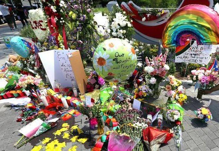 Siguen las investigaciones en torno a la matanza en el bar gay Pulse, que dejó 49 víctimas. (AP)
