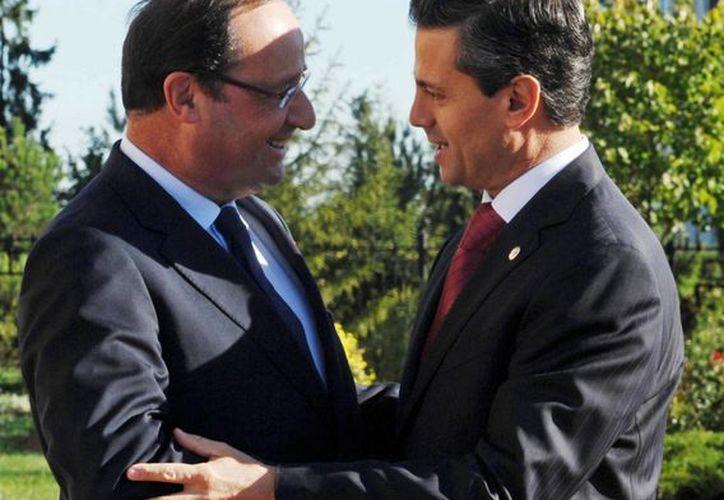 Meses después de reunirse el presidente Enrique Peña con el presidente francés Francois Hollande, Florence Cassez fue liberada. (Notimex)