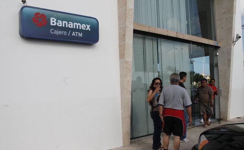 Las instituciones bancarias que encabezan la lista negra con las cantidades más grandes de las controversias presentadas por los usuarios son: Banco Nacional de México y BBVA Bancomer. (Jesús Tijerina/SIPSE)