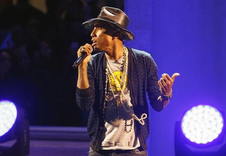 """Pharrell Williams destacó que """"el presente es un regalo, y si uno quiere simplemente celebrar su felicidad, debe poder hacerlo"""". (AP)"""