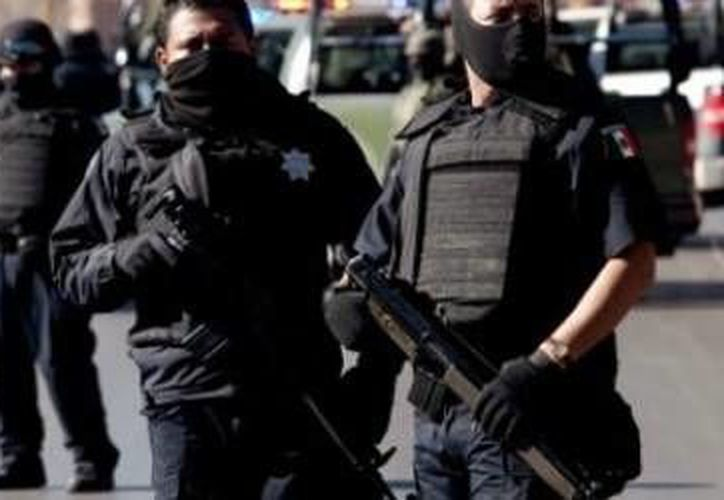 La detención de los 11 hombres se llevó a cabo por agentes federales cuando trataban de raptar a una persona en el Estado de México. (Notimex/Foto de archivo)