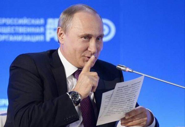 Rusia reduce su presupuesto por más de 70 millones de dolares para el Mundial de fútbol que organizará en 2018. En la foto, el presidente Vladimir Putin. (AP)