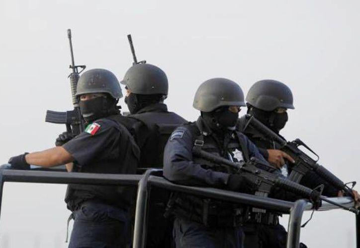 Juan Antonio Franco Bustos, exdirector del Estado Mayor de la Policía Estatal de Hidalgo fue acusado de proteger a los Zetas. En la foto, policías federales que combaten al crimen organizado. (Foto de contexto. Archivo SIPSE)