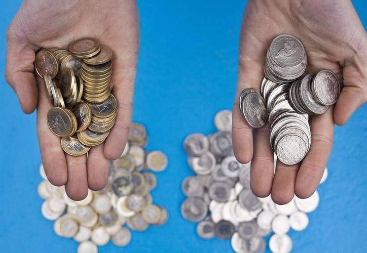 Suiza buscar restringir el pago de grandes sumas de dinero a ejecutivos de empresas. (EFE/Archivo)