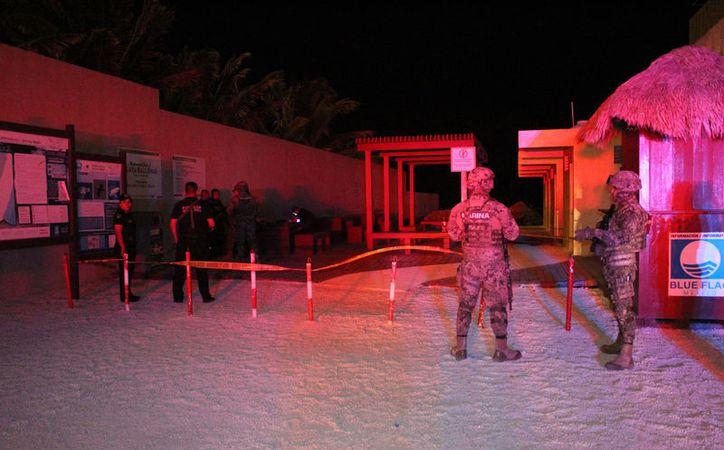 El área fue acordonada por los elementos policíacos y militares. (Foto: Redacción)