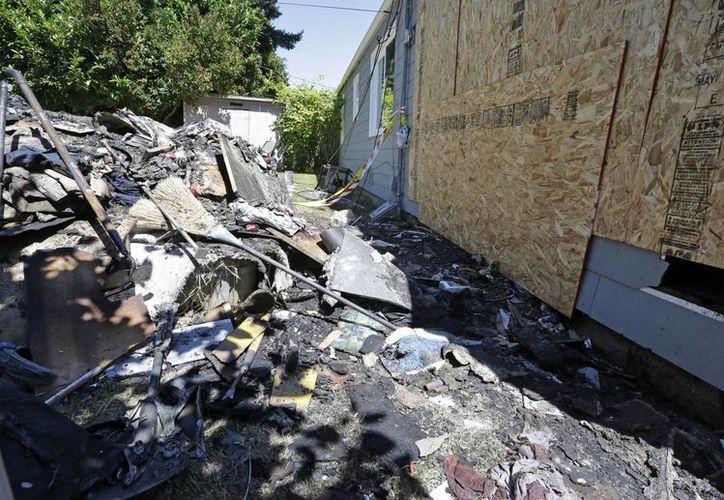 Así quedó la vivienda luego del incidente ocurrido la noche del martes 15 de julio de 2014. (Foto: Elaine Thompson/AP)