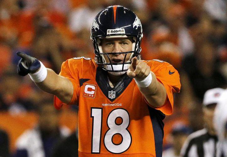 Manning, el mejor deportista del año según Sports Illustrated, está a tres pases de touchdown de empatar el récord de la NFL, que es de 47 y está en poder de Tom Brady. (Agencias)