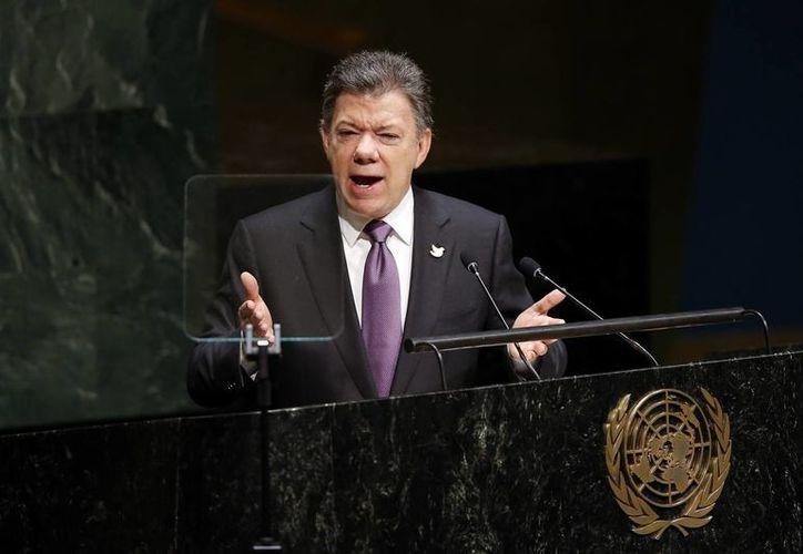 El presidente de Colombia Juan Manuel Santos, dijo ante la Asamblea General de la ONU que también contempla sentarse a la mesa de negociaciones con otra guerrilla, el ELN. (Agencias)