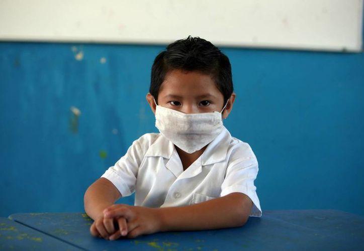 La influenza comienza como un cuadro gripal, con tos y dolor de cuerpo. Los niños son los más vulnerables a esta enfermedad. (Milenio Novedades)