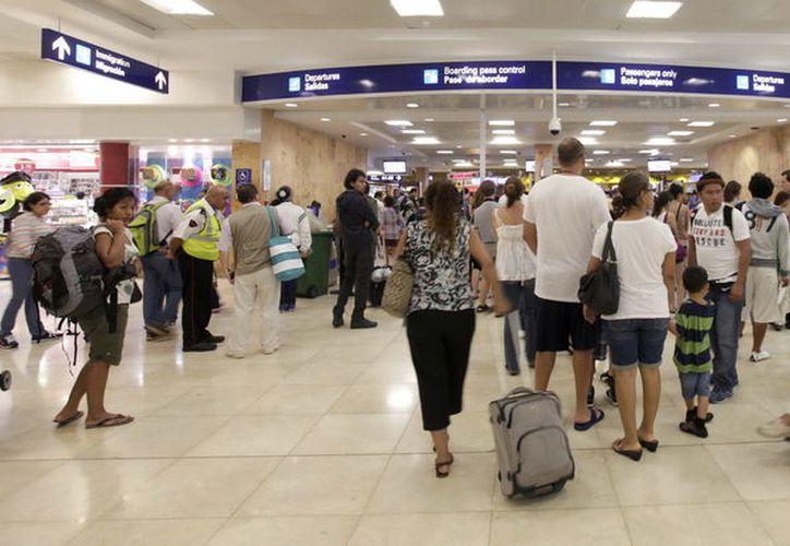 Esperan que la terminal aérea de Cancún cierre con la cifra histórica de 23 millones de pasajeros. (Foto: Contexto/Internet)