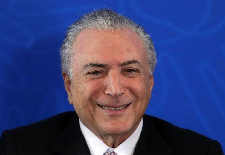Solamente el 14 por ciento de los brasileños aprueba el desempeño del actual mandatario Michel Temer. (AP)