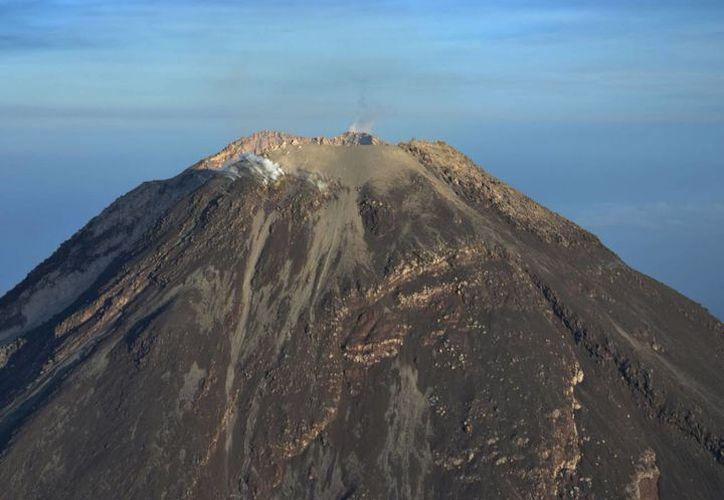 Se mantiene la alerta en Colima ante la lluvia y posibles lahares en zona cercanas al Volcán de Fuego. (Archivo/Notimex)