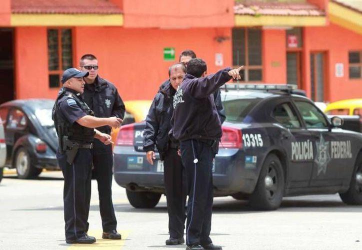 Los policías de la PESP y federales resultaron ilesos, pero un vehículo oficial registró varios impactos de bala. (Agencias/Contexto)