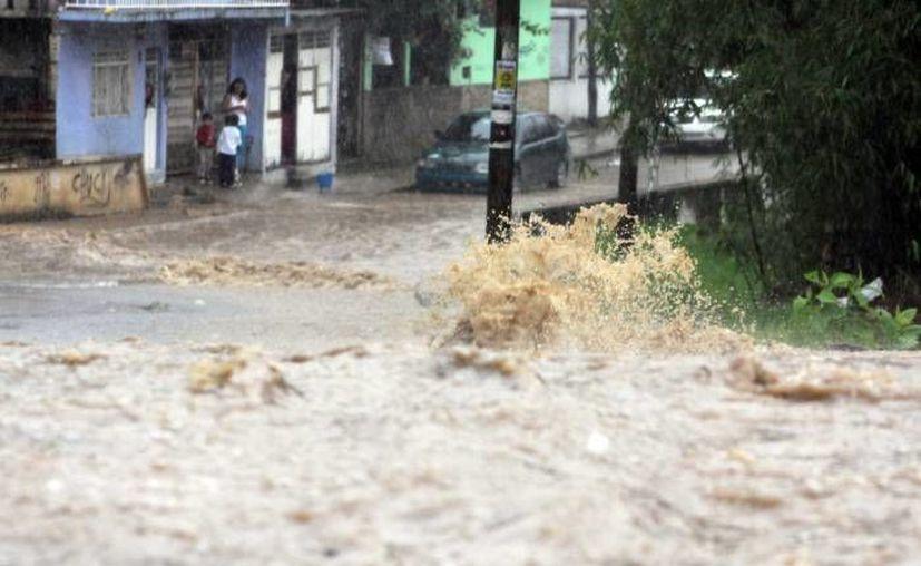 Mientras las lluvias se intensifican, se espera en Veracruz y Tamaulipas el impacto de la tormenta tropical Ingrid. (Notimex/Foto de contexto)
