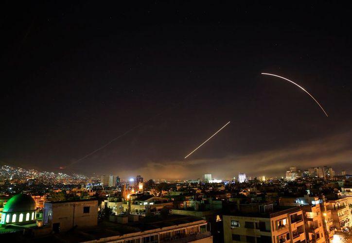 El ataque se llevó a cabo al instante en que el presidente lo anunciaba desde Estados Unidos. (AP)