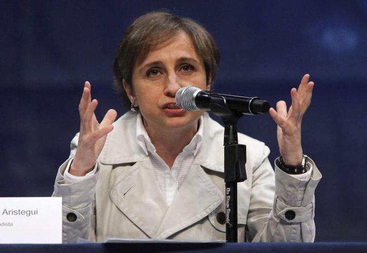 Ningún ministro de la SCJN quiso hacer suya la petición de atraer el caso Aristegui-MVS. Fotografía de la periodista, Carmen Aristegui, durante una conferencia ante cientos de personas en el Auditorio del Complejo Cultural Universitario de la Benemérita Universidad Autónoma de Puebla el año pasado. (Archivo/Notimex)