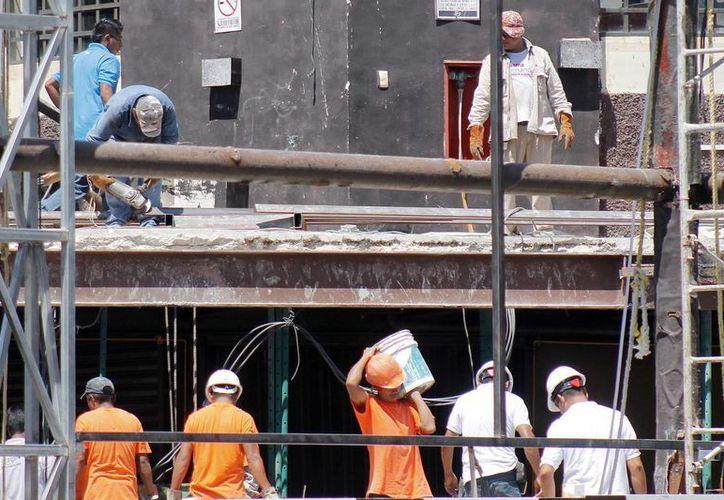 En Quintana Roo 82 de cada 100 hombres laboran. (Jesús Tijerina/SIPSE)