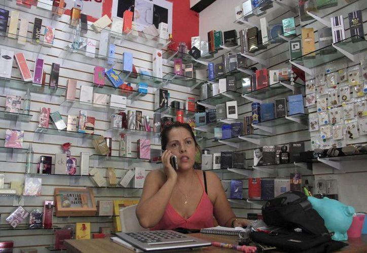 Ella administra su propio negocio. (Tomás Álvarez/SIPSE)