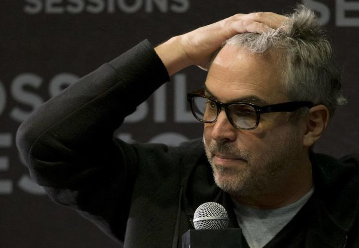 El director de cine Alfonso Cuarón, ganador del Oscar por Gravity, durante una conferencia de prensa ayer, en la ciudad de México. (Foto: AP/Rebecca Blackwell)