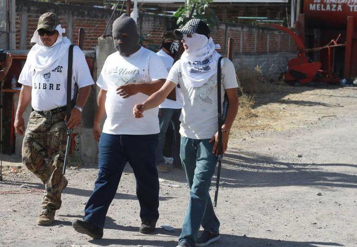 Los detenidos fungían como guardias comunitarias de Felipe Carrillo Puerto (La Ruana), en Michoacán. (Archivo/Notimex)