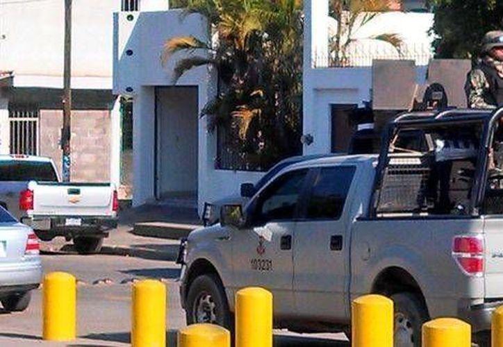 Los detenidos en Sinaloa tenían en su poder 91 armas de uso exclusivo del Ejército. (Milenio)