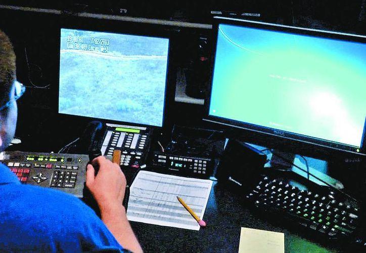 El monitoreo con cámaras digitales es apoyado con sobrevuelos de aviones no tripulados. (Milenio Novedades)