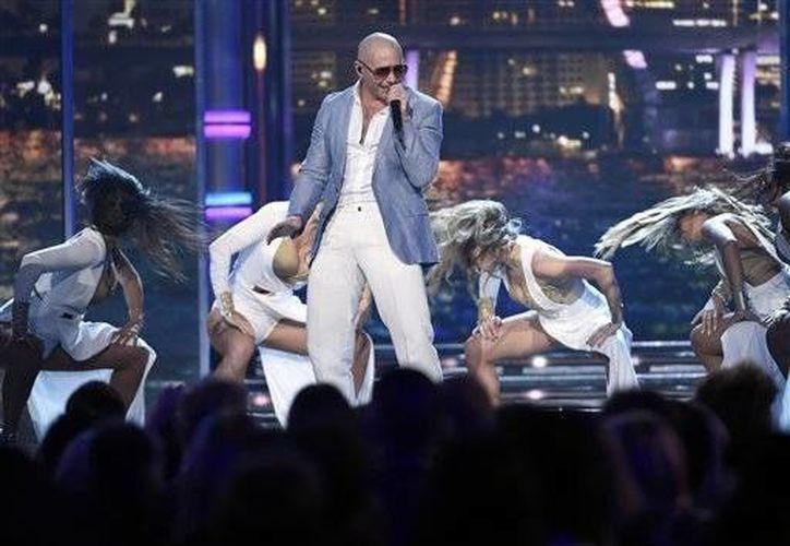 Pitbull está nominado al Grammy por mejor álbum de rock latino, urbano o alternativo por  'Dale' .(Notimex)