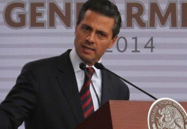 """En su artículo para El País sobre las reformas el presidente Enrique Peña señaló que uno de los objetivos es """"elevar la productividad de México para impulsar el crecimiento y el desarrollo económico"""". (Notimex/Foto de archivo)"""
