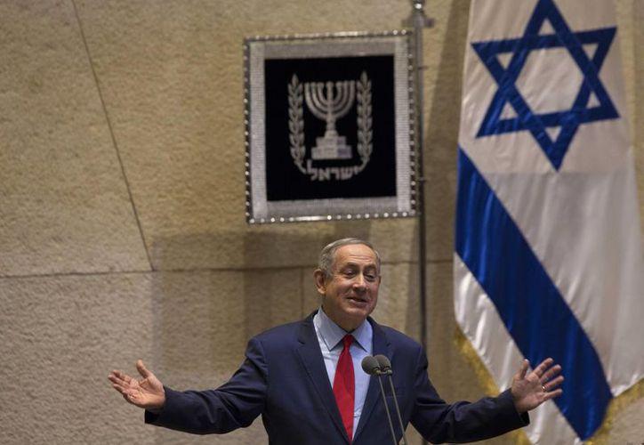 El primer ministro israelí es el principal sospechoso de una investigación sobre corrupción que también involucra a su familia. (AP/Sebastian Scheiner)