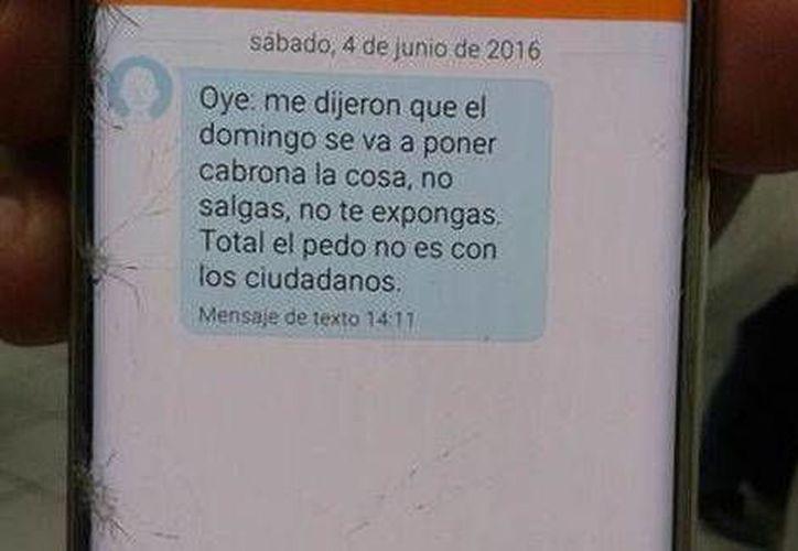 Veracruzanos recibieron este domingo mensajes vía celular como el de la imagen con el fin de inhibirlos de salir a votar. (Milenio Digital)