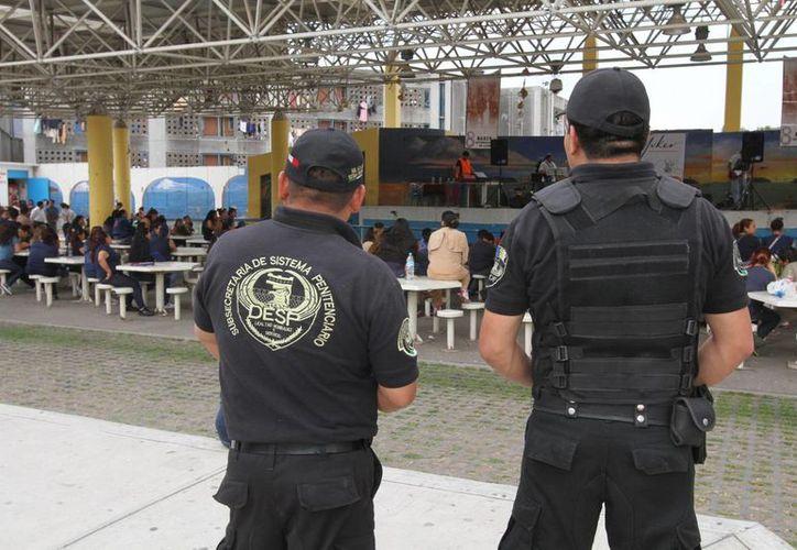 Unos 15 mil internos del Distrito Federal cuentan con un trabajo como parte de su rehabilitación. (Archivo/Notimex)