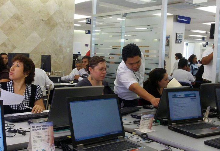 Atención de expertos en las oficinas locales del SAT. (Milenio Novedades)