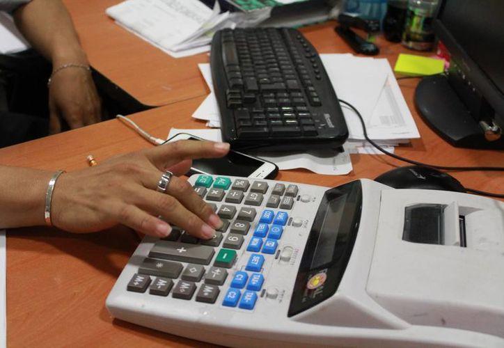 A nivel nacional hay 22 mil contadores colegiados y considerando el número alto de egresados el número anual de nuevos socios debería ser de 30 o 40%. (Luis Soto/SIPSE)