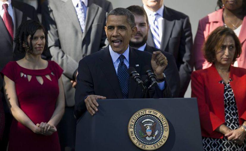 Obama insistió el lunes que la ley es algo más que una página en internet. (Agencias)
