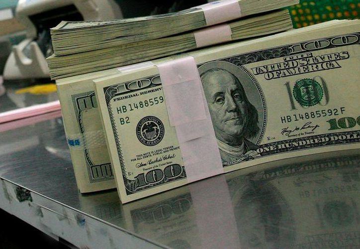 El precio del dólar superó este jueves los 15 pesos por unidad. (Archivo/SIPSE)