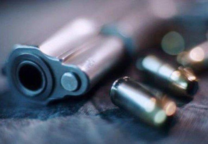 La pistola pertenecía a la madre del menor, quien fue encarcelada a la espera de que se le acuse formalmente. (Archivo/SIPSE)