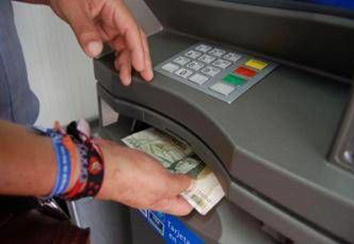 Los bancos del centro de la ciudad también son resguardados. (Archivo/SISPE)