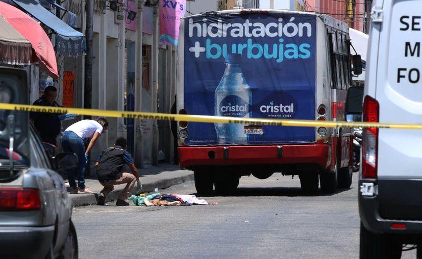 El cadáver de la mujer, desconocida hasta ayer, quedó completamente aplastado; la imagen era dantesca. (Foto: Milenio Novedades)