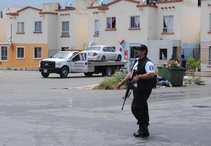 El cuerpo apareció en un vehículo en Villas Otoch Paraíso. (Redacción)
