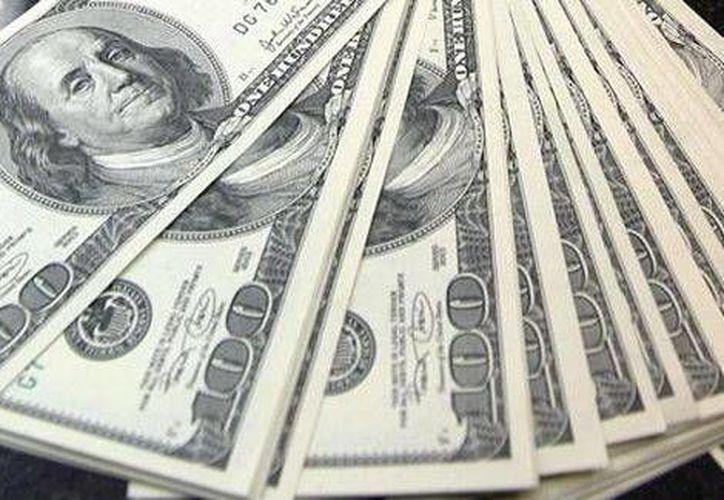 En los cinco primeros meses de 2014, el envío de dinero al país acumuló una suma de 9 mil 580.3 millones de dólares.   (Milenio/Foto especial)